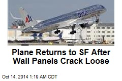 Plane Returns to SF After Wall Panels Crack Loose