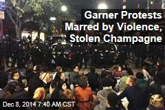 Garner Protests Marred by Violence, Stolen Champagne