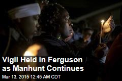 Vigil Held in Ferguson as Manhunt Continues