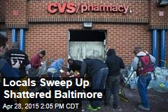 Locals Sweep Up Shattered Baltimore