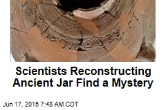 Scientists Reconstructing Ancient Jar Find a Mystery