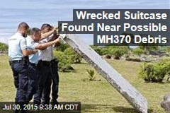 Wrecked Suitcase Found Near Possible MH370 Debris