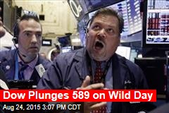 Dow Plunges 589 on Wild Day
