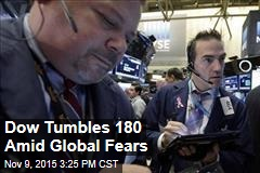 Dow Tumbles 180 Amid Global Fears