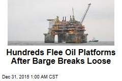 Hundreds Flee Oil Platforms After Barge Breaks Loose