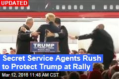 Secret Service Agents Rush to Protect Trump at Rally