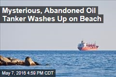 Mysterious, Abandoned Oil Tanker Washes Up on Beach