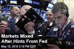 Markets Mixed After Hints From Fed