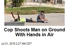 Cop Shoots Man on Ground With Hands in Air