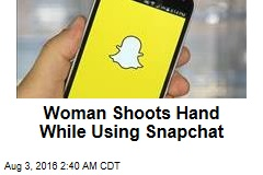 Woman Shoots Hand While Using Snapchat