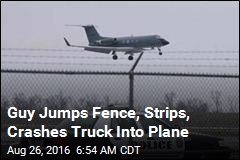 Guy Jumps Fence, Strips, Crashes Truck Into Plane