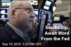 Stocks Dip, Await Word From the Fed