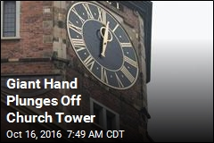 Giant Hand Plunges Off Church Tower
