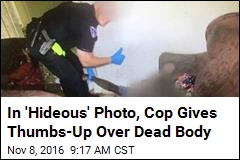 In 'Hideous' Photo, Cop Gives Thumbs-Up Over Dead Body