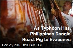 As Typhoon Hits, Philippines Dangle Roast Pig to Evacuees