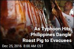 As Typhoon Hits, Philippines Dangle Roast Pig to Evacuees