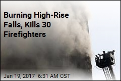 Burning High-Rise Falls, Kills 30 Firefighters