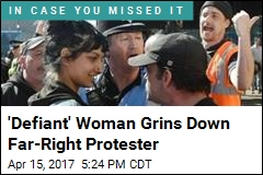 'Defiant' Woman Grins Down Far-Right Protester