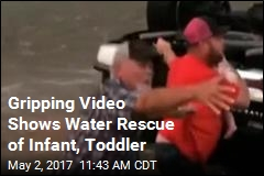 Gripping Video Shows Water Rescue of Infant, Toddler