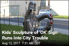 City Moving Kids' Sculpture Over Gang Symbol Fears