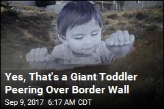 Yes, That's a Giant Toddler Peering Over Border Wall