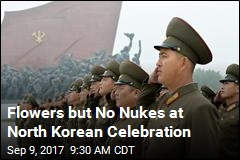 Flowers but No Nukes at North Korean Celebration
