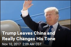 After Leaving China, Trump Talks Tough on Trade