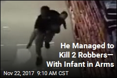 Off-Duty Cop With Infant in Arms Kills Robbers
