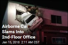 Airborne Car Slams Into 2nd-Floor Office