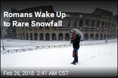 Romans Wake Up to Rare Snowfall