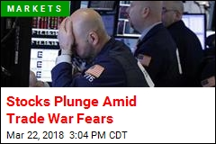 Dow Plunges 724 Points Amid Trade War Fears