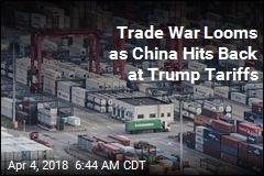 Trade War Looms as China Hits Back at Trump Tariffs