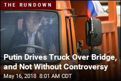 Why Putin Got Behind the Wheel of a Big Orange Truck
