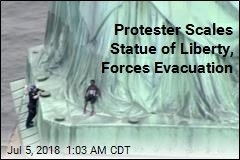 Protester Scales Statue of Liberty, Forces Evacuation