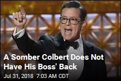 A Somber Colbert Does Not Have His Boss' Back