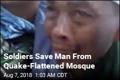 Soldiers Save Man From Quake-Flattened Mosque