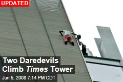 Two Daredevils Climb Times Tower