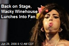 Back on Stage, Wacky Winehouse Lurches Into Fan