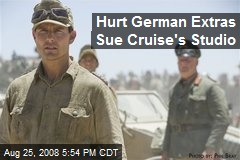 Hurt German Extras Sue Cruise's Studio