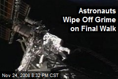 Astronauts Wipe Off Grime on Final Walk