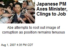 Japanese PM Axes Minister, Clings to Job