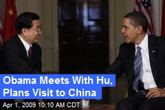 Obama Meets With Hu, Plans Visit to China