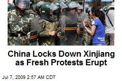 China Locks Down Xinjiang as Fresh Protests Erupt