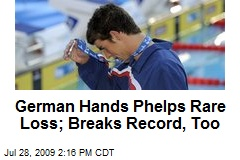 German Hands Phelps Rare Loss; Breaks Record, Too