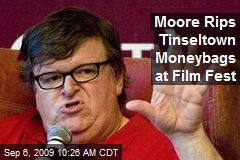 Moore Rips Tinseltown Moneybags at Film Fest