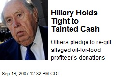 Hillary Holds Tight to Tainted Cash