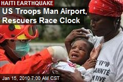 US Troops Man Airport, Rescuers Race Clock