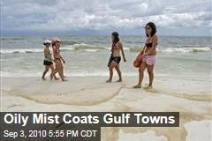 Oily Mist Coats Gulf Towns