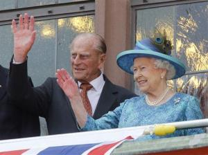 This is a Thursday, June 25, 2015 file photo of Britain's Queen Elizabeth II and her husband Prince Philip,  as they wave from the balcony of the Roemer town hall in Frankfurt, Germany.